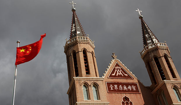The Chinese national flag flies in front of a Catholic church in the village of Huangtugang, Hebei province, China, Sept. 30, 2018. (CNS photo/Thomas Peter, Reuters)